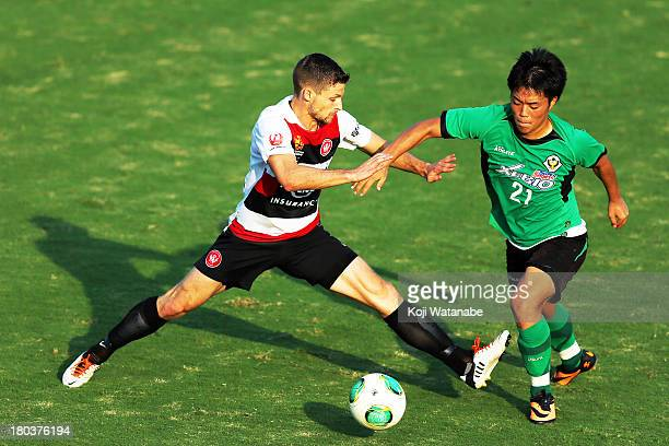 Shannon Cole of Western Sydney Wanderers and Daisuke Takagi of Tokyo Verdy compete for the ball during the match between Western Sydney Wanderers v...