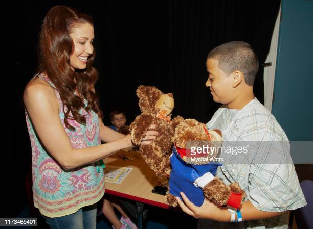 Shannon Elizabeth and Mt Sinai patient Josue Morales and Diane Rode Assistant Professor at Mt Sinai attends Teddy Bear Day for the enCourage Kids...