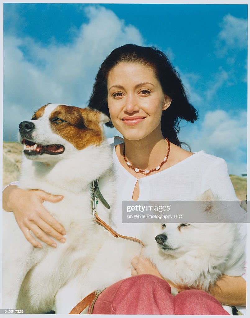 Shannon Elizabeth Holding Dogs