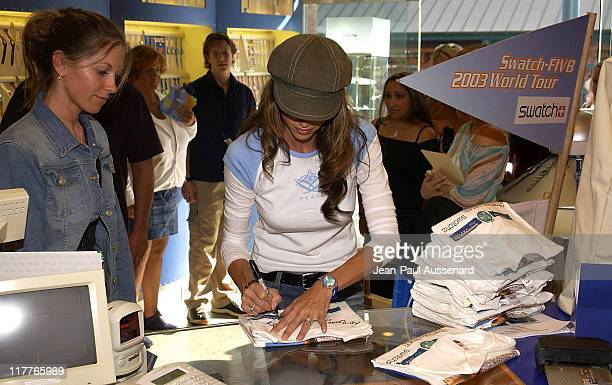 Shannon Elizabeth signing a Swatch FIVB Olympic Qualifier Pro Beach Volleyball teeshirt for a guest