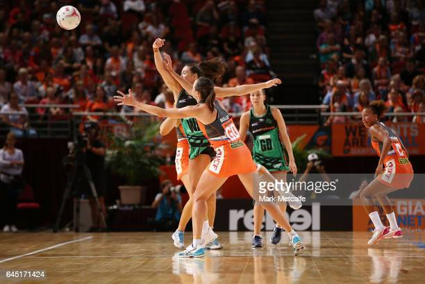 Shannon England of the Fever and Bec Bulley of the Giants contest possession during the round two Super Netball match between the Giants and the West...