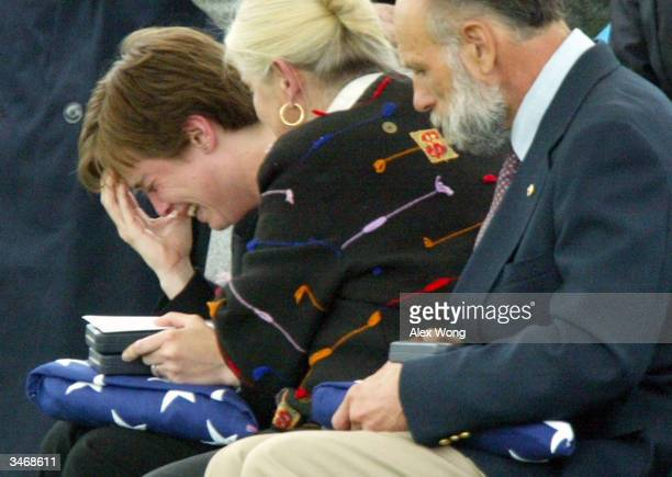 Shannon Enos wife of Sgt Peter Enos who was killed in Iraq cries as she is comforted by motherinlaw Deborah during the sergeant's funeral at...