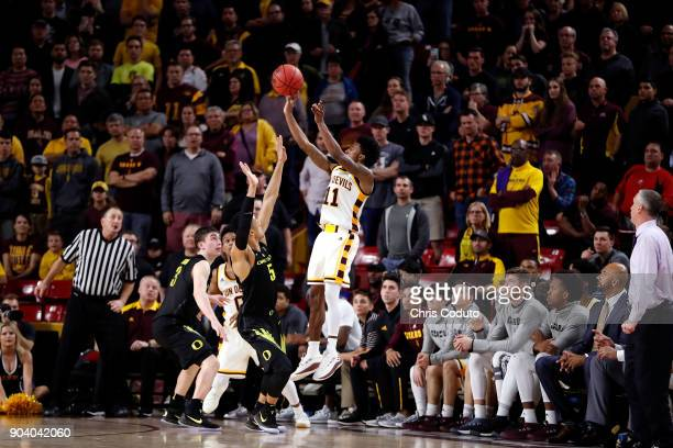 Shannon Evans II of the Arizona State Sun Devils shoots over Elijah Brown of the Oregon Ducks during the second half of the college basketball game...