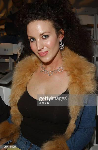 Shannon Factor wearing jewelry by Judith Ripka and jacket by Sheri Bodell