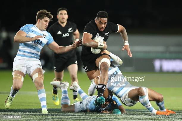 Shannon Frizzle of the New Zealand All Blacks is tackled during The Rugby Championship match between the New Zealand All Blacks and Argentina at...