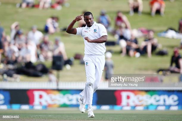 Shannon Gabriel of the West Indies celebrates taking the wicket of Mitchell Santner of New Zealand during day one of the second Test match between...