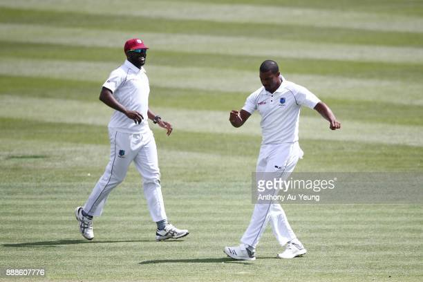 Shannon Gabriel of the West Indies celebrates the wicket of Jeet Raval of New Zealand during day one of the second Test match between New Zealand and...