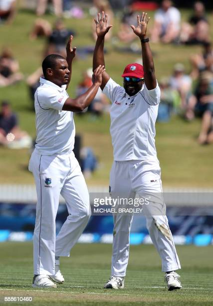Shannon Gabriel of the West Indies celebrates the wicket of New Zealand's Jeet Raval during day one of the second Test cricket match between New...