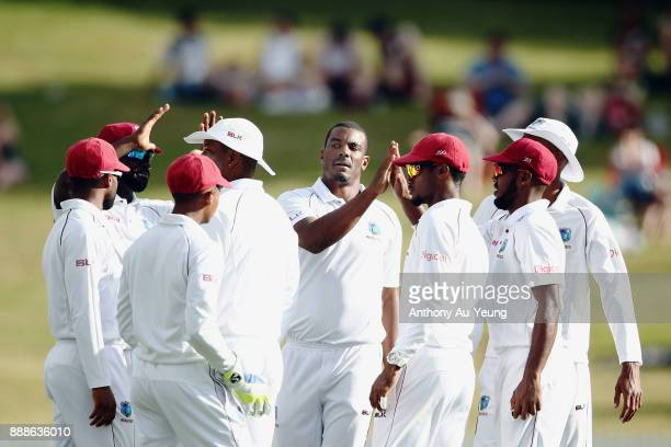 Shannon Gabriel of the West Indies celebrates with teammates for the wicket of Colin de Grandhomme of New Zealand during day one of the second Test...
