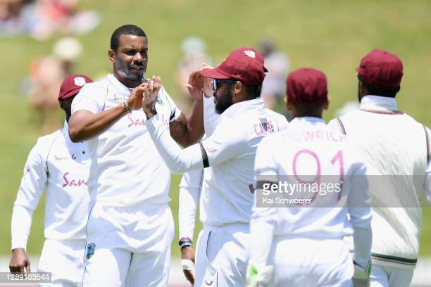 Shannon Gabriel of the West Indies is congratulated by team mates after dismissing Will Young of New Zealand during day one of the First Test match...
