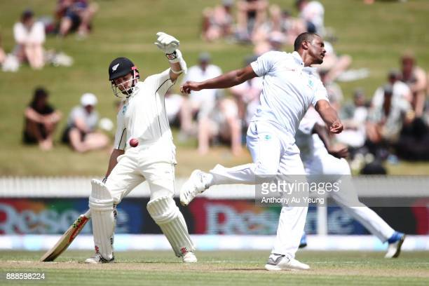 Shannon Gabriel of the West Indies tries to catch off his own bowl as Kane Williamson of New Zealand looks on during day one of the second Test match...