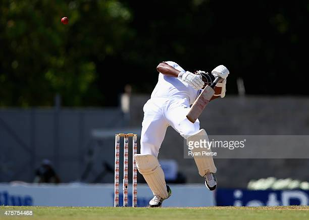 Shannon Gabriel of West Indies avoids a bouncer bowled by Mitchell Johnson of Australia during day one of the First Test match between Australia and...