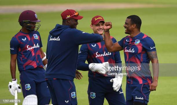 Shannon Gabriel of West Indies celebrates taking the wicket of John Campbell of West Indies with teammate Jason Holder during Day One of a West...