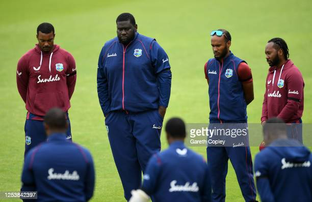 Shannon Garbiel Rahkeem Cornwall Kraigg Braithwaite and Jomel Warrican of the West Indies observe a minutes silence with their team mates in memory...