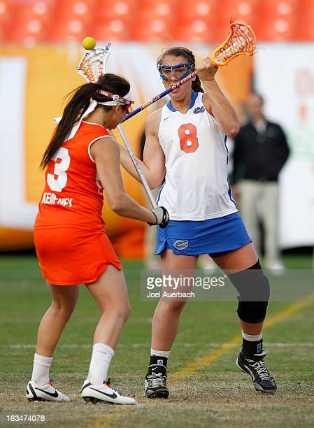 Shannon Gilroy of the Florida Gators and Kailah Kempney of the Syracuse Orange battle for the ball during the 2013 Orange Bowl Lacrosse Classic on...