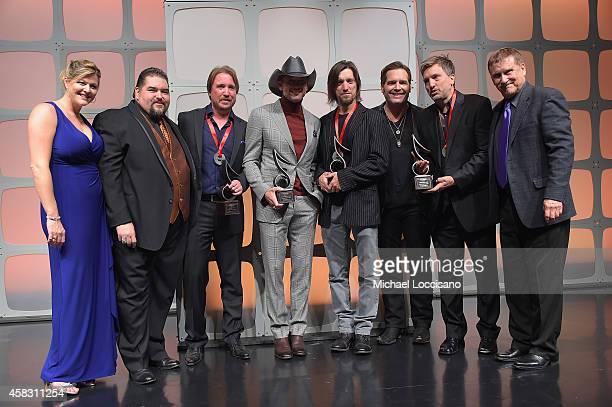 Shannon Hatch Tim Fink Lance Miller Tim McGraw Brad Warren Bret Warren and John Mullins onstage at the SESAC 2014 Nashville Music Awards at Country...