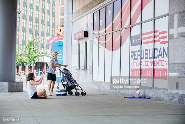 Shannon Holter a resident of Chagrin Falls makes a photo of her six month old son Ethan in front of Quicken Loans Arena on July 11 2016 in Cleveland...