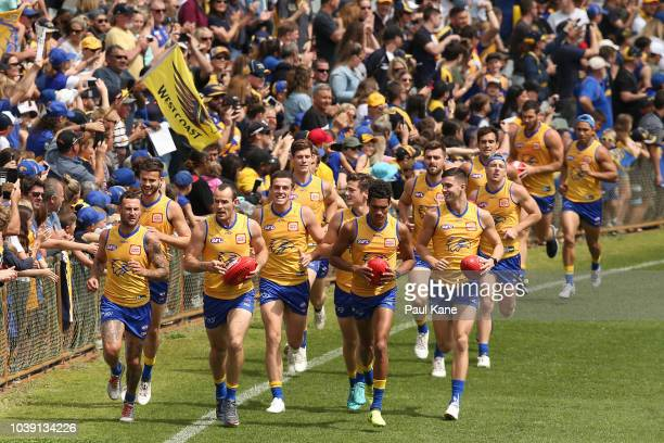 Fans show their support during a West Coast Eagles AFL training session at Subiaco Oval on September 24 2018 in Perth Australia