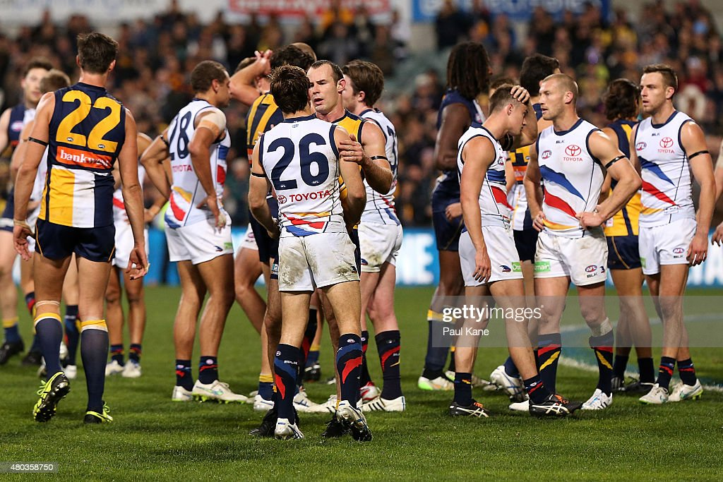 Shannon Hurn of the Eagles acknowledges Richard Douglas of the Crows after the round 15 AFL match between the West Coast Eagles and the Adelaide Crows at Domain Stadium on July 11, 2015 in Perth, Australia.