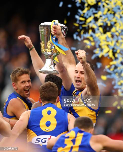 Shannon Hurn of the Eagles and Adam Simpson coach of the Eagles hold the premiership cup aloft after winning the 2018 AFL Grand Final match between...