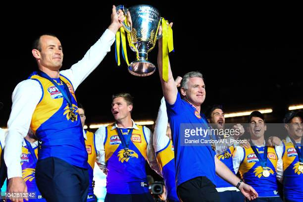 Shannon Hurn of the Eagles and Adam Simpson coach of the Eagles present the Cup to their fans during the 2018 Toyota AFL Grand Final match between...