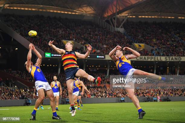 Shannon Hurn of the Eagles and Josh Jenkins of the Crows compete for the ball during the round 15 AFL match between the Adelaide Crows and the West...