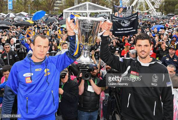 Shannon Hurn of the Eagles and Scott Pendlebury of the Magpies hold up the Premiership Trophy infront of the crowd during the 2018 AFL Grand Final...