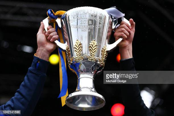 Shannon Hurn of the Eagles and Scott Pendlebury of the Magpies hold up the Premiership Cup during the 2018 AFL Grand Final Parade on September 28...