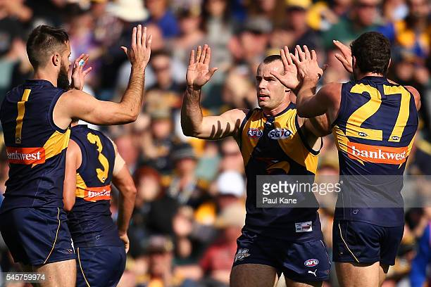 Shannon Hurn of the Eagles celebrates a goal during the round 16 AFL match between the West Coast Eagles and the North Melbourne Kangaroos at Domain...