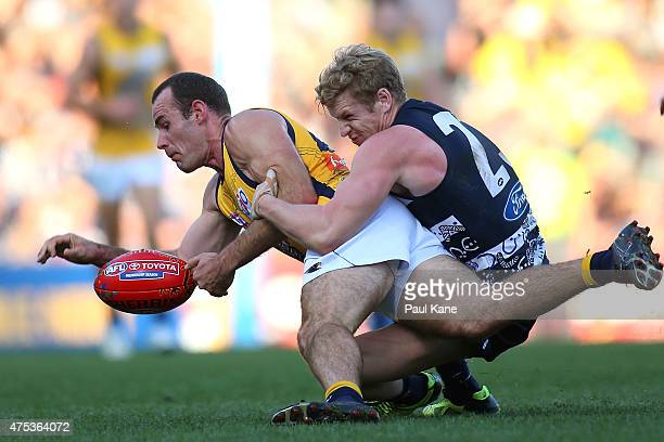 Shannon Hurn of the Eagles gets tackled by Josh Caddy of the Cats during the round nine AFL match between the West Coast Eagles and the Geelong Cats...