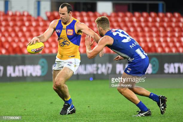 Shannon Hurn of the Eagles kicks during the round 18 AFL match between the North Melbourne Kangaroos and the West Coast Eagles at Metricon Stadium on...