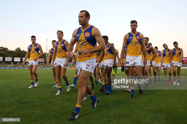 Shannon Hurn of the Eagles leads his team from the field after being defeated during the JLT Community Series AFL match between the Fremantle Dockers...