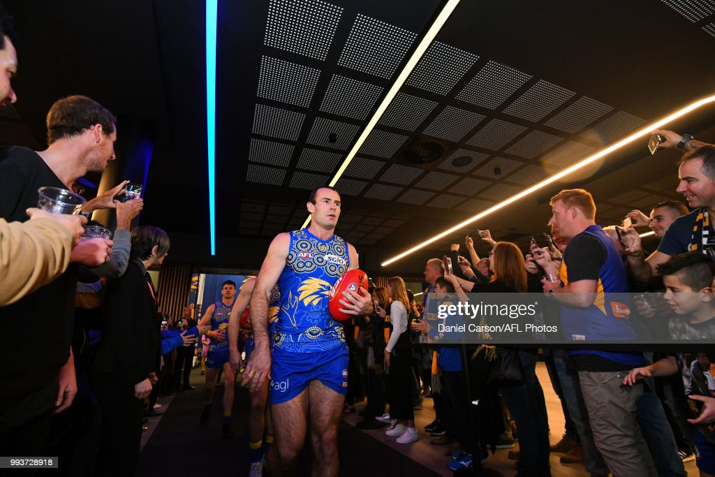 Shannon Hurn of the Eagles makes his way through the fans to the arena during the 2018 AFL round 16 match between the West Coast Eagles and the GWS Giants at Optus Stadium on July 08, 2018 in Perth, Australia.