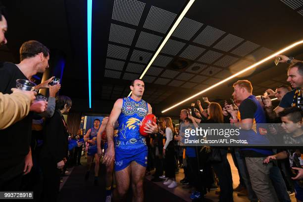 Shannon Hurn of the Eagles makes his way through the fans to the arena during the 2018 AFL round 16 match between the West Coast Eagles and the GWS...