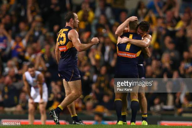 Shannon Hurn Sam Mitchell and Luke Shuey of the Eagles celebrate winning the round eight AFL match between the West Coast Eagles and the Western...