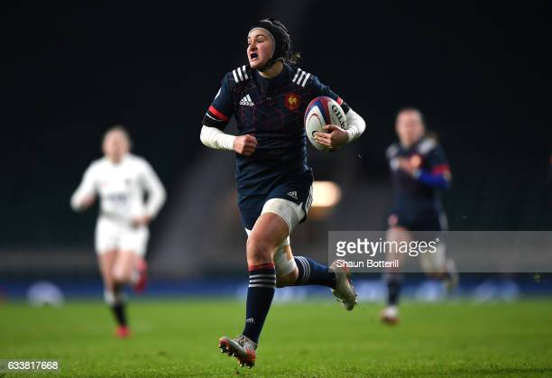 Shannon Izar of France breaks through to score her sides first try during the Women's Six Nations match between England and France at Twickenham...