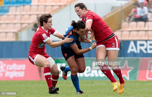 Shannon Izar of France vies for the ball with Ghislane Landry and Kelly Russell of Canada during a World Rugby Women's Sevens Series match in Barueri...