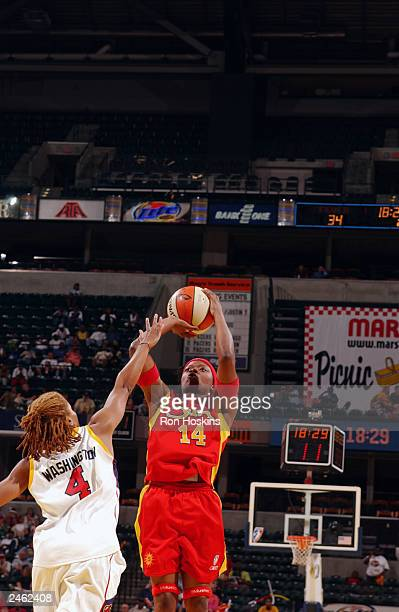Shannon Johnson of the Connecticut Sun shoots over Coquese Washington of the Indiana Fever during the game at Conseco Fieldhouse on August 25 2003 in...