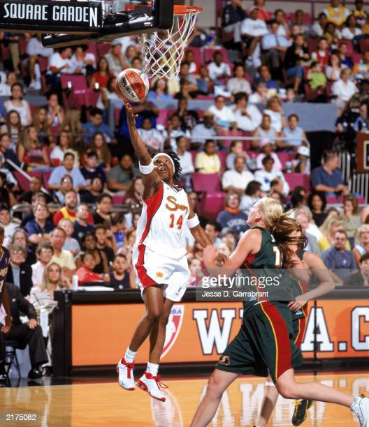 Shannon Johnson of the Connecticut Sun takes the layup during the 2003 WNBA East/West AllStar Game at Madison Square Garden on July 12 2003 in New...
