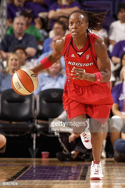 Shannon Johnson of the Houston Comets pushes the ball upcourt against the Phoenix Mercury during the game on September 7 2008 at US Airways Center in...