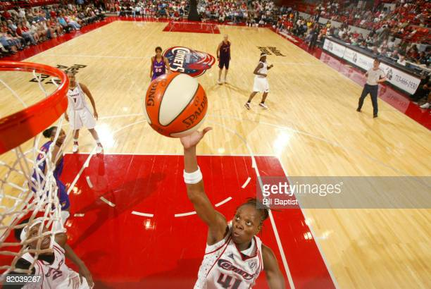 Shannon Johnson of the Houston Comets shoots the ball at Reliant Arena July 22, 2008 in Houston, Texas. NOTE TO USER: User expressly acknowledges and...