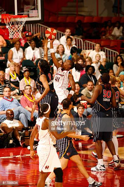 Shannon Johnson of the Houston Comets shoots the ball over Tammy Sutton-Brown of the Indiana Fever at Reliant Arena on June 28, 2008 in Houston,...