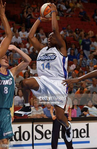 Shannon Johnson of the Orlando Miracle shoots a runner in the lane over Kelly Miller of the Charlotte Sting on July 12 2002 in a game at TD...