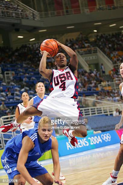 Shannon Johnson of the USA attempts a shot over Anastasia Kostaki of Greece during the women's basketball quarterfinal game on August 25 2004 during...