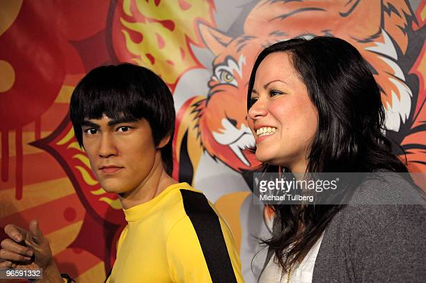 Shannon Lee daughter of the late martial arts actor Bruce Lee gets interviewed during the unveiling of a new lifelike wax statue of her father at...
