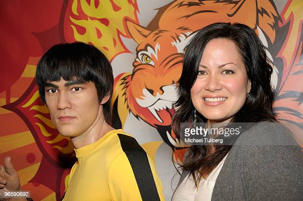Shannon Lee daughter of the late martial arts actor Bruce Lee poses with a new lifelike wax statue of her father at its unveiling at Madame Tussaud's...
