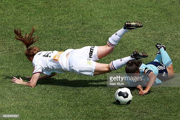 Shannon May of Perth trips over Teresa Polias of Sydney FC during the round seven WLeague match between Sydney FC and the Perth Glory at WIN Jubilee...
