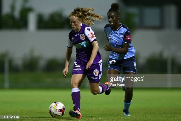 Shannon May of the Perth Glory controls the ball against Princess Ibini of Sydney during the round 11 WLeague match between the Perth Glory and...