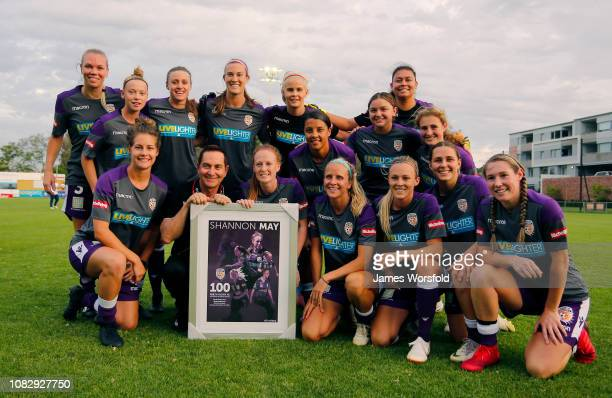 Shannon May of the Perth Glory is handed a commemorative frame for her 100 game milestone during the round seven WLeague match between the Perth...