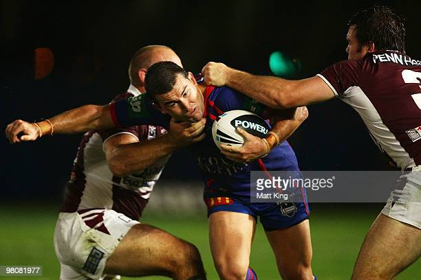 Shannon McDonnell of the Knights takes on the defence during the round three NRL match between the Manly Warringah Sea Eagles and the Newcastle...